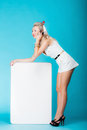 Sexy woman with blank presentation board banner sign talking phone retro style blonde in full length girl holds billboard copy Stock Photography