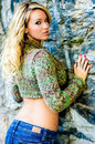 Sexy woman blonde model in sweater girl green sweather long hair with curls curly hair trendy urban fashion Royalty Free Stock Photography