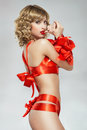 woman bound with red gift ribbon