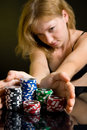 Sexy woman casino poker play blonde cards green rich Stock Image