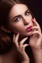 Sexy woman with creative make up looking at camera close of young blonde hair and hands near her face Stock Images