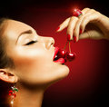 Sexy woman eating cherry sensual red lips with cherries Stock Image