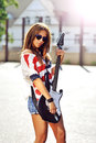 Sexy woman with electric guitar outdoor Royalty Free Stock Photo