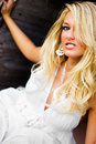Sexy woman farm girl blonde model in country fashion white dress long hair with curls curly hair next door Royalty Free Stock Image