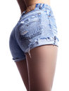 woman in fashion blue jeans shorts. Perfect hot booty and erotic curves hips. Good body shapes whithout cellulite Royalty Free Stock Photo