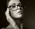 Sexy woman in glasses looking hot black and white portrait Stock Photos