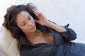 Sexy woman with headphones Royalty Free Stock Images