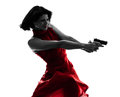 Sexy woman holding gun silhouette one caucasian in studio isolated on white background Royalty Free Stock Image