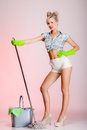 Sexy woman housewife cleaner with mop full length girl retro style in domestic role traditional sharing household chores pin up Stock Image