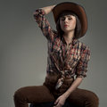 Sexy woman in an image of the American cowboy Stock Photography