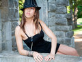 Sexy Woman Leaning on an Old Stone Wall Royalty Free Stock Photo