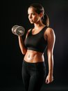 Sexy woman lifting a dumbbell photo of toned young female exercising with dumbbells Royalty Free Stock Images