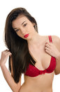 Sexy woman with long beautiful hair wearing a red bra attractive girl with a sexy cleavage isolated on white Royalty Free Stock Images