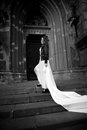 Sexy woman with long white veil walking on stairs of old abbey Royalty Free Stock Images