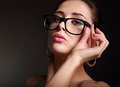 Sexy woman looking hot on modern glasses dark background Stock Photography