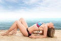 Sexy woman lying on sand Stock Photo