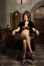 Sexy woman in a medieval interior Stock Photography