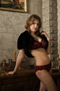 Sexy woman in a medieval interior castle Royalty Free Stock Photo