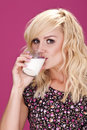 Sexy woman and milk. Royalty Free Stock Photography