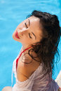 Sexy woman near swimming pool sensual sitting the on a hot day Stock Images
