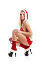A sexy woman posing in erotic Christmas clothes Royalty Free Stock Photo