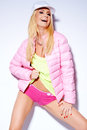 Sexy woman posing in pink jacket and shorts she standing isolated on white Royalty Free Stock Photos