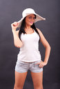 Sexy woman posing with white hat in studio Stock Photos