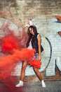 Sexy woman in rabbit ears waving red smoke bombs anger outdoors lifestyle portrait Royalty Free Stock Image