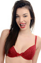 Sexy woman in red bra being sexy with her tongue out attractive girl with a sexy cleavage isolated on white Stock Photos