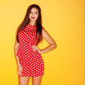 Sexy woman in red polka dot dress hot wearing dots with black stiletto Stock Image