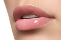 woman's lips. Beauty lips make-up. Beautiful make-up. Sensual open mouth. Lipstick and lip gloss. Natural full lips