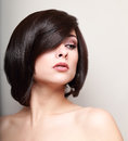 woman with short black hair. Hair style.