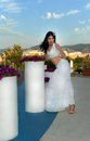 Sexy woman in sicily beautiful brunette long white skirt stand near modern vase cafe italy Royalty Free Stock Images