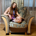 image photo : Sexy woman sitting on the armchair