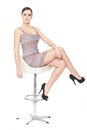 Sexy Woman Sitting on Chair Stock Photography