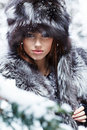 Sexy woman in snowy winter outdoors Royalty Free Stock Photo
