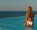 Sexy woman standing in infinity pool Stock Image