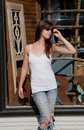 Sexy Woman in Sunglasses Outside Antique Store Royalty Free Stock Photography