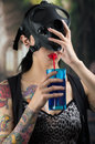 Sexy woman taking off a ammo gas mask and drinking wearing Stock Photos