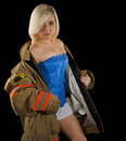Sexy woman taking off her mans firemans jacket a beautiful young blonde with coat over shoulders Stock Images