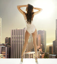Sexy woman on the terrace in the skyscraper lady Royalty Free Stock Image
