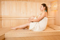 Sexy woman in towel relaxing at steam bath photo of Royalty Free Stock Photo