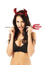 Sexy woman with trident in mouth lingerie Stock Photo