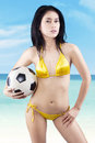 Sexy woman wearing bikini holding a soccer ball Royalty Free Stock Photo