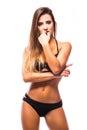 Sexy woman wearing navy black swimwear posing on white background. Royalty Free Stock Photo