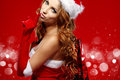 Sexy woman wearing santa clause costume Stock Photo