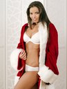 Sexy woman wearing santa coat photo of a beautiful in her underwear posing with a claus jacket as a gift Stock Photo