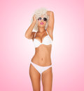 Sexy woman wearing white bikini on pink Stock Photo