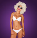 Sexy woman wearing white bikini on purple Stock Photography