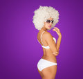 Sexy woman wearing white bikini on purple Royalty Free Stock Images